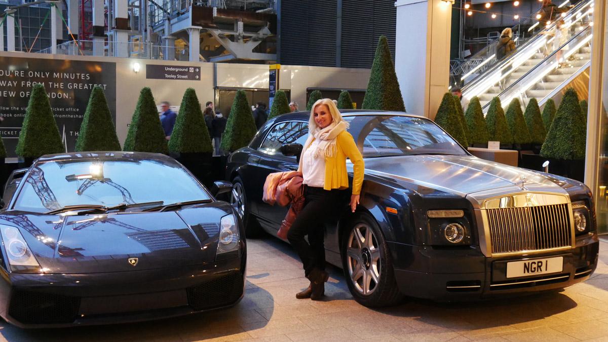 Blogger Ana-Maria Hota posing in front of Ferrari-Rolls-Roys